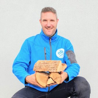 Eamon holding some kiln dried firewood blocks