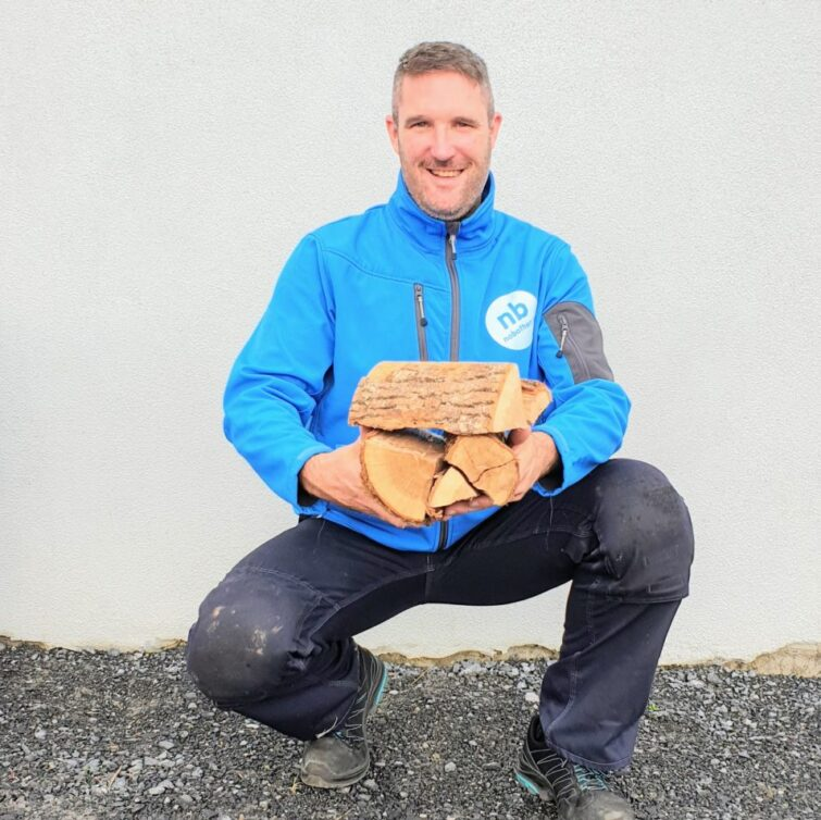 Eamon holding some kiln dried firewood blocks